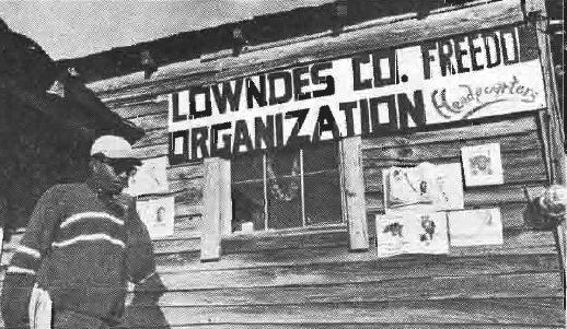 Bob Mants in front of the Lowndes County Freedom Organization's office, photograph by Doug Harris
